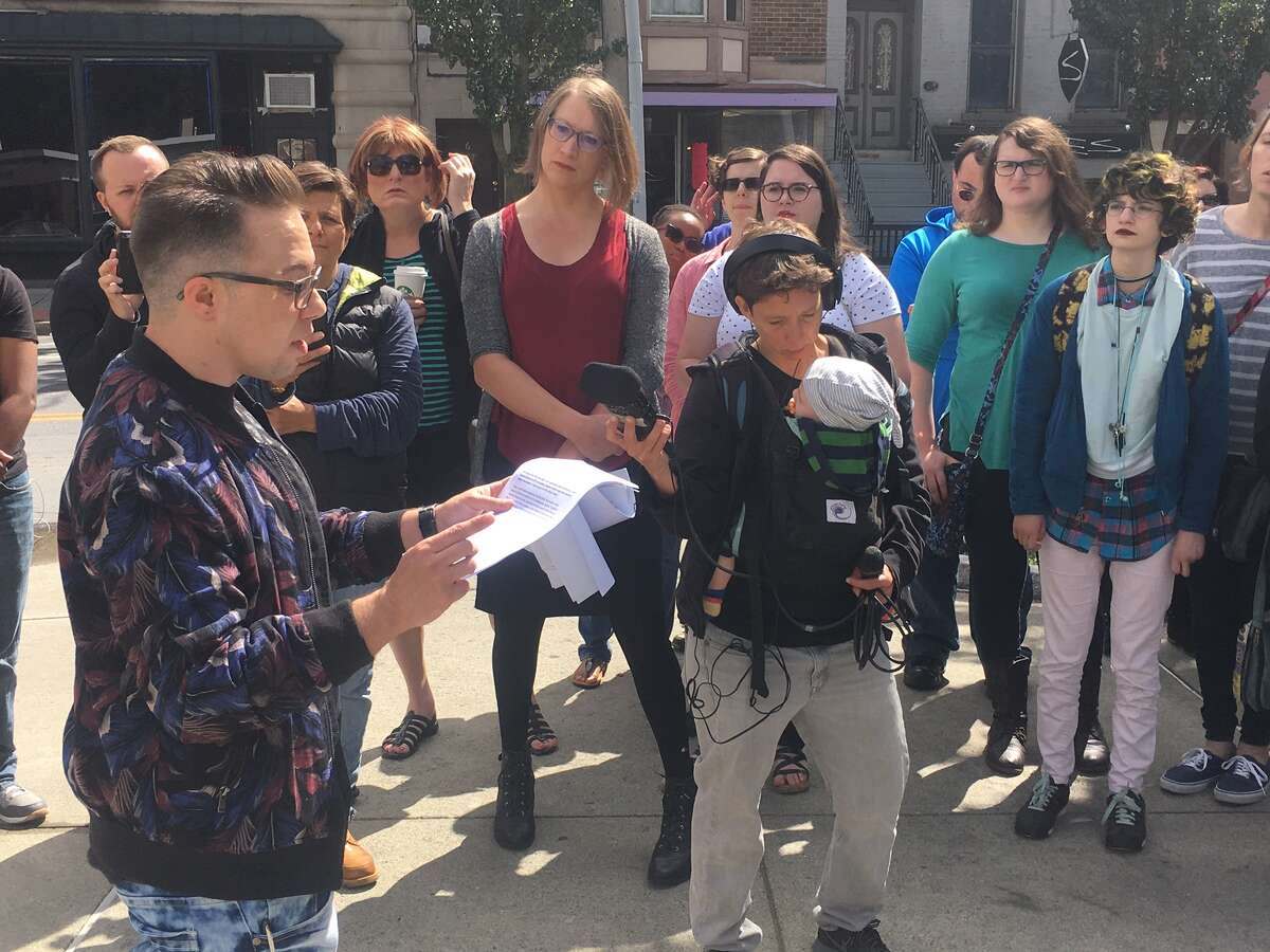 Eoghann Renfroe speaks Saturday at a rally in Dana Park in Albany calling for leadership changes at the Pride Center of the Capital Region. The group, of about two dozen, walked a letter of demands over to the center on Hudson Street after the rally.