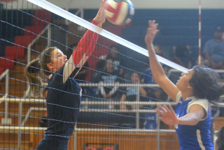 Plainview's Lexi Bennett goes above the net to block a Palo Duro shot during a junior varsity volleyball match at the Plainview High School gym Saturday afternoon. The Lady Bulldog jayvees opened their District 3-5A season on a successful note with a 25-21, 21-19 sweep of the visiting Lady Dons. Photo: Skip Leon/Plainview Herald