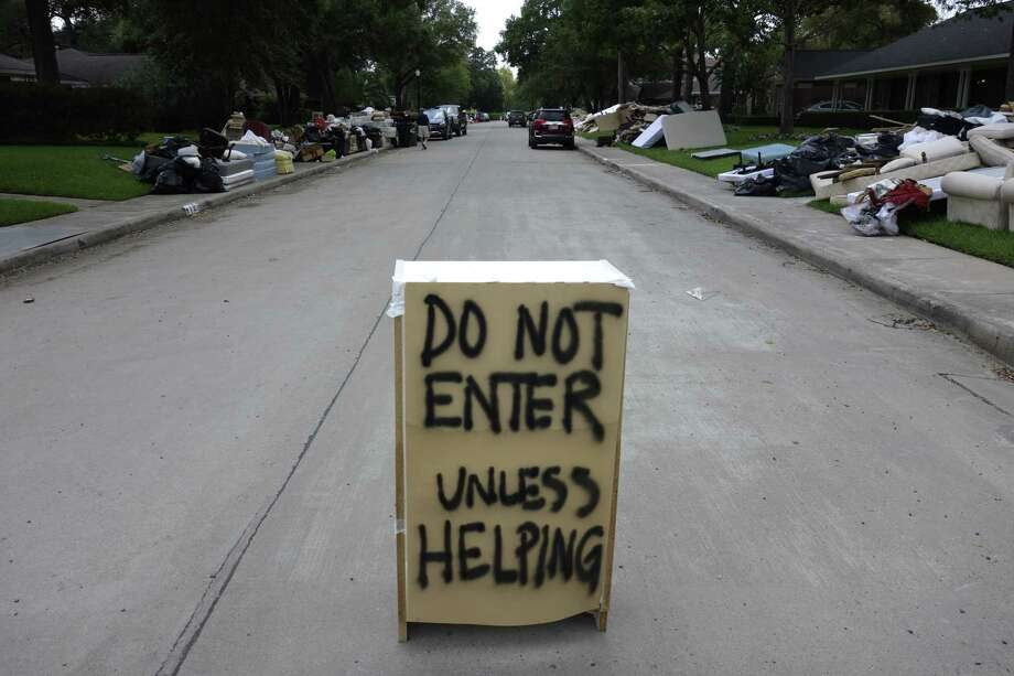 """A """"Do Not Enter"""" sign is placed on Tartan Lane in Houston more than a week after Harvey swamped the region. Photo: Brian Melley, STF / Copyright 2017 The Associated Press. All rights reserved."""