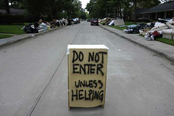 "A ""Do Not Enter"" sign is placed on Tartan Lane in Houston more than a week after Harvey swamped the region."