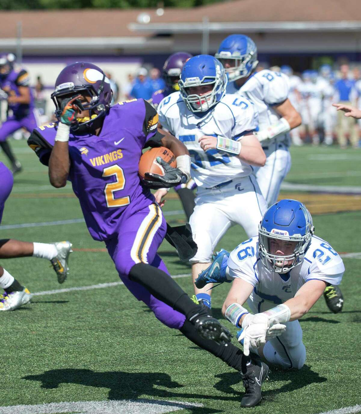 Westhill's Noldylens Metayer avoids being tackled by Fairfield Ludlowe's Jake Simonelli during Saturday's football game at Westhill High School in Stamford, Conn., on September 9, 2017.