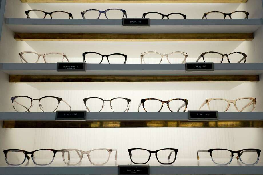 Warby Parker eyewear is displayed at a company retail store, Wednesday, Sept. 6, 2017, in New York. At Warby Parker, you can pick out five frames to try for five days for free. (AP Photo/Mark Lennihan) ORG XMIT: NYML601 Photo: Mark Lennihan / Copyright 2017 The Associated Press. All rights reserved.