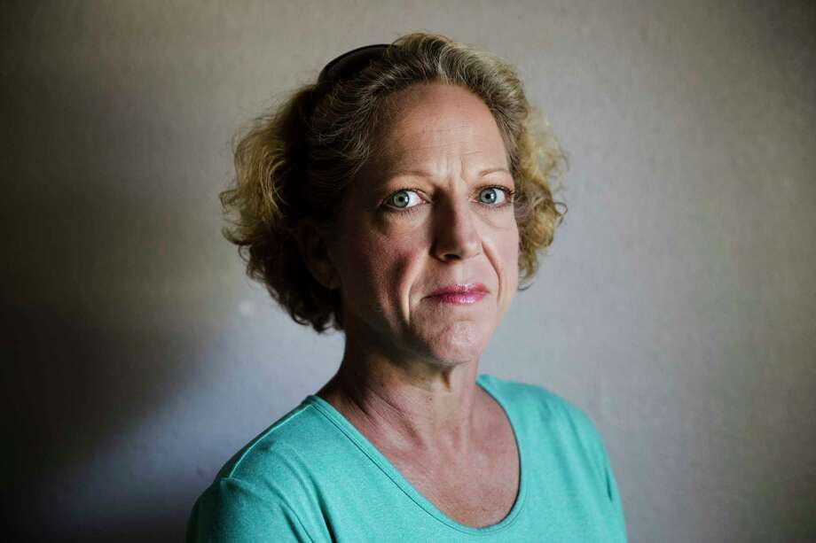 Julie Boon, director of Eudaimonia Recovery Homes poses for a photograph at one of her facility damaged by Hurricane Harvey on Friday, Sept. 8, 2017, in Houston. In the aftermath of flooded Houston, Julie Boon oversaw repairs at a sober-living home while giving advice to residents based on her own 30 years of sobriety. (AP Photo/Matt Rourke) Photo: Matt Rourke, STF / Copyright 2017 The Associated Press. All rights reserved.