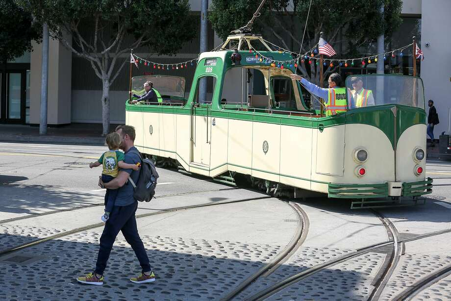An open-top 1934 boat tram from Blackpool, England, takes to the tracks during Muni Heritage Weekend in San Francisco. Photo: Amy Osborne, Special To The Chronicle