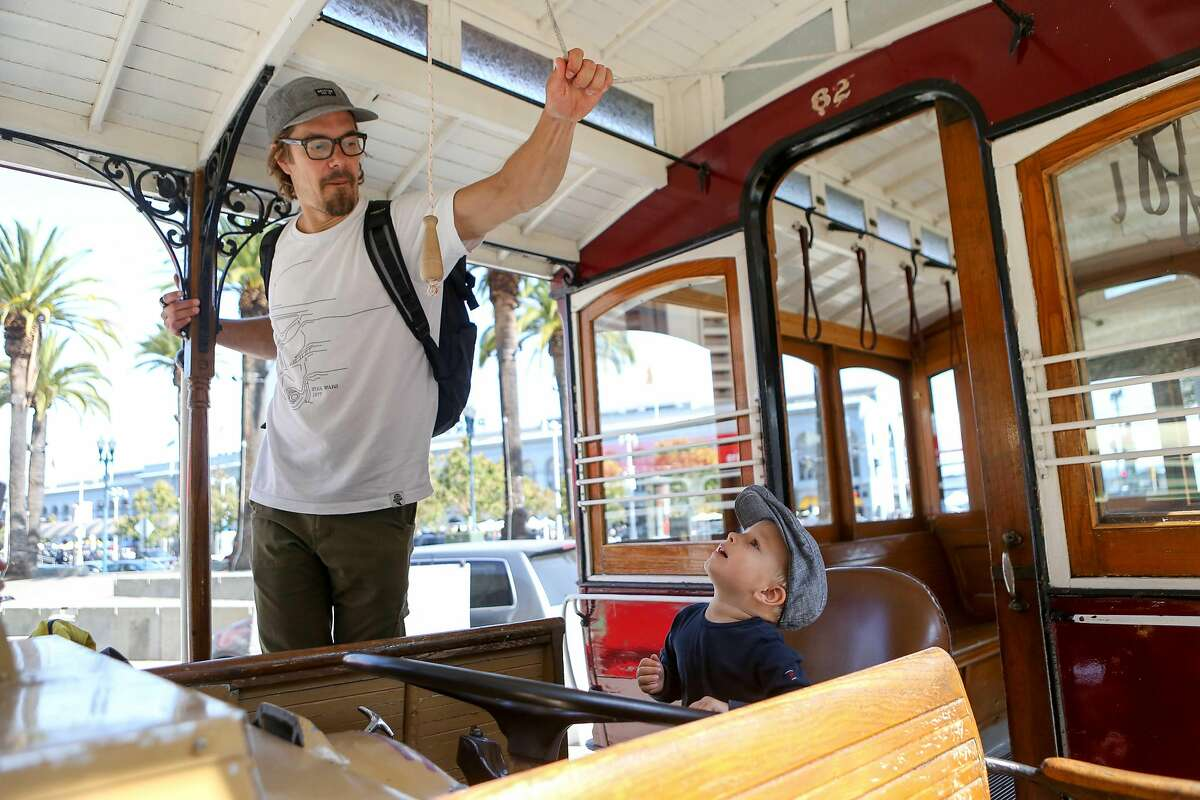 Ari Tulla and son Max, 2, play inside of a vintage streetcar on display during the Muni Heritage Weekend on Saturday, September 9, 2017 in San Francisco, Calif.