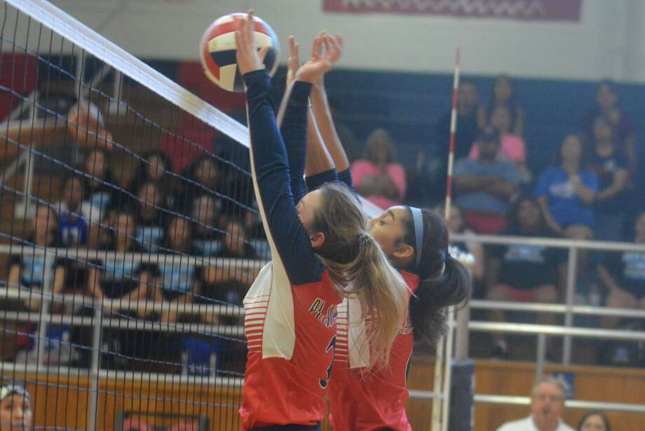 Plainview's Paisleigh Wilkins, foreground, and Kayla Soto, background, combine to block a shot by Palo Duro during the opening District 3-5A volleyball match at the Plainview High School gym Saturday afternoon. Photo: Skip Leon/Plainview Herald