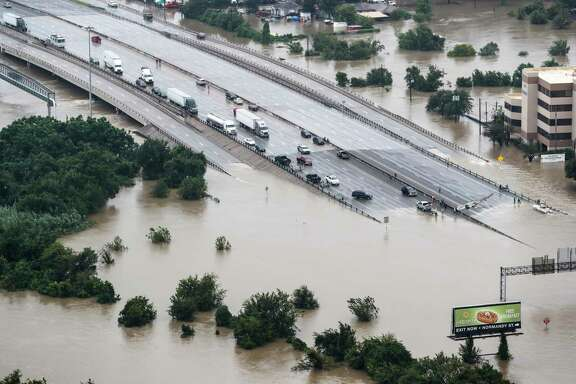 Floodwaters from Tropical Storm Harvey block Interstate  10 at Market. While Houston built its way into this flooding predicament, it cannot build its way out.