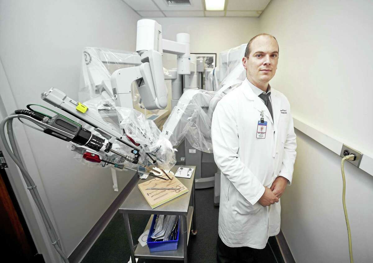Dr. Brian Shuch, assistant professor of urology and radiology at the Yale School of Medicine, is photographed with the da Vinci Surgical System in the Surgical Simulation Lab at Yale New Haven Hospital in New Haven.