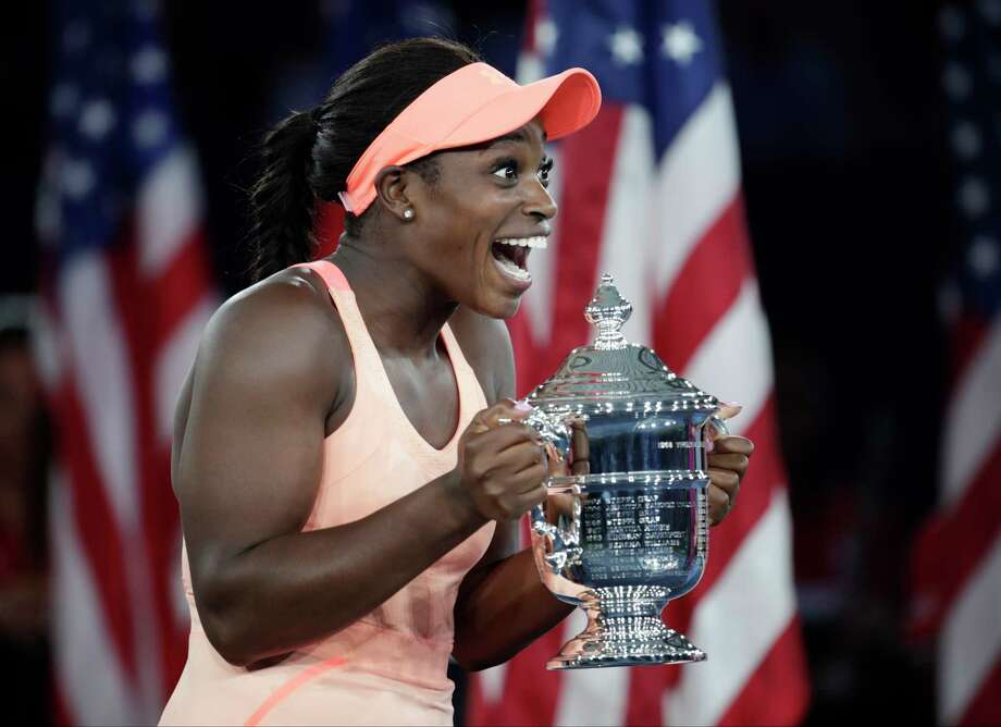 Sloane Stephens, of the United States, holds up the championship trophy after beating Madison Keys, of the United States, in the women's singles final of the U.S. Open tennis tournament, Saturday, Sept. 9, 2017, in New York. (AP Photo/Julio Cortez) Photo: Julio Cortez, STF / Copyright 2017 The Associated Press. All rights reserved.