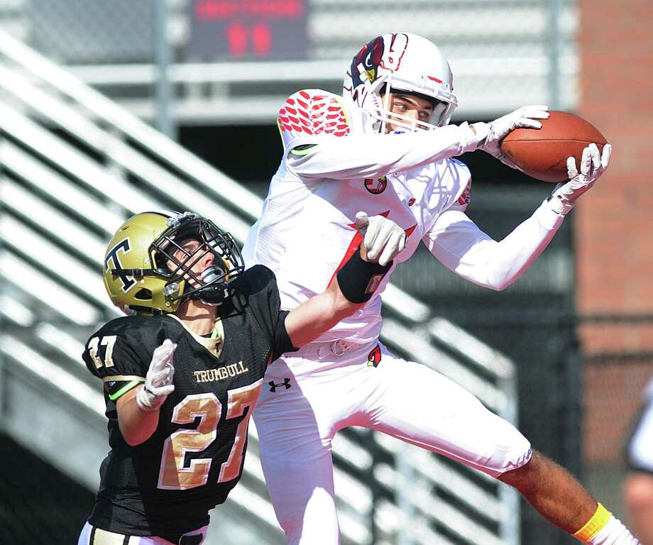 Greenwich receiver Elias Gianopoulos, right, beats Trumbull defender Devin DiCocco (#27) to score a touchdown on a second quarter pass thrown by Greenwich quarterback Gavin Muir during the high school football game between Greenwich High School and Trumbull High School at Sacred Heart University in Fairfield, Conn., Saturday, Sept. 9, 2017. Greenwich won the game defeating Trumbull, 70 - 16. Photo: Bob Luckey Jr. / Hearst Connecticut Media / Greenwich Time