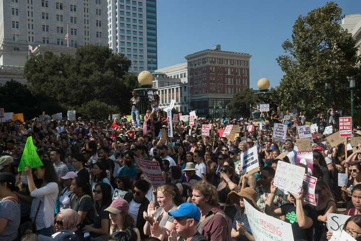 Crowd protesting President Trumps decision to end DACA at Frank Ogawa Plaza on Saturday, Sept. 9, 2017 in Oakland, CA.