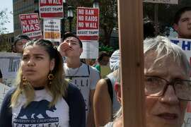 Andrea Octaviano, Andriaqn Gonzalez and Myrna Shadley protesting President Trumps decision to end DACA at Frank Ogawa Plaza on Saturday, Sept. 9, 2017 in Oakland, CA.