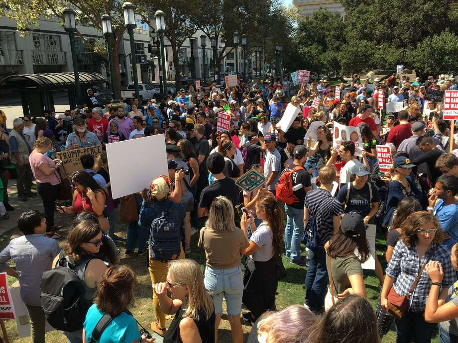 Hundreds of demonstrators fill Frank H. Ogawa Plaza in downtown Oakland to protest President Trump's decision to phase out an executive order that had protected from deportation many young adults who were brought to the U.S. by their undocumented parents.