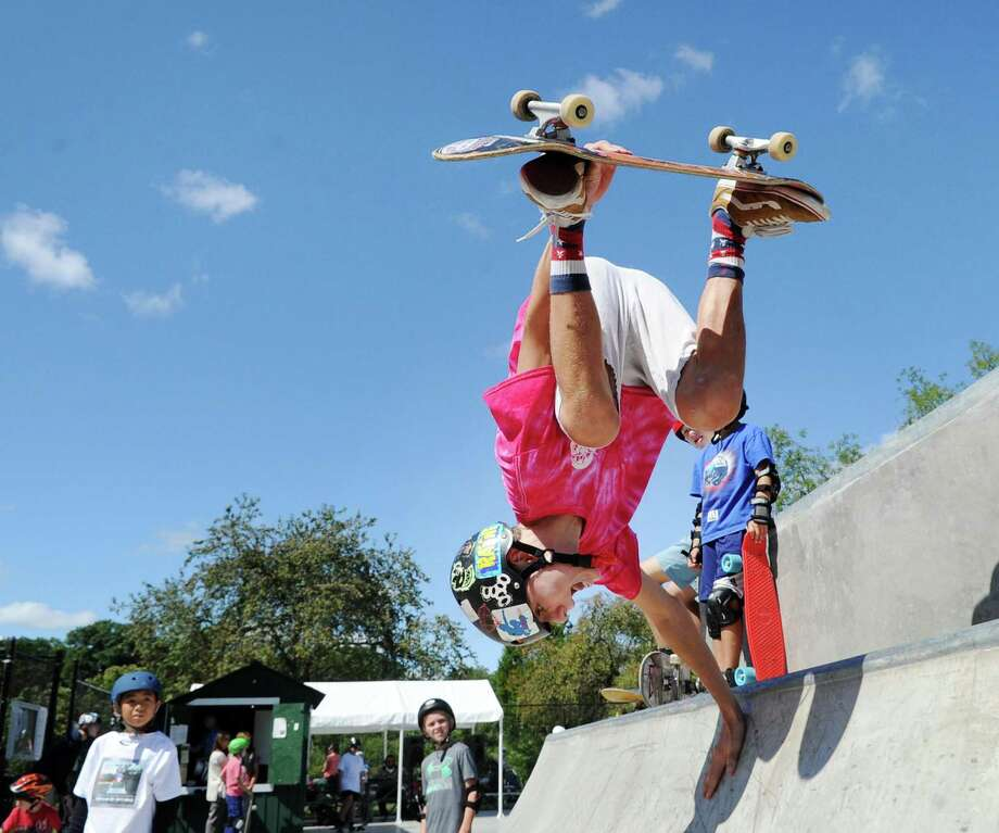 Martin Curley, 16, of Greenwich, demonstrates a handstand move during the Grand Opening of the Greenwich Skatepark at Roger Sherman Baldwin Park in Greenwich, Conn., Saturday, Sept. 9, 2017.  Curley is an instructor at the skatepark. Photo: Bob Luckey Jr. / Hearst Connecticut Media / Greenwich Time