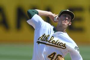 OAKLAND, CA - SEPTEMBER 09:  Daniel Gossett #48 of the Oakland Athletics pitches against the Houston Astros in the top of the first inning during game one of a doubleheader at Oakland Alameda Coliseum on September 9, 2017 in Oakland, California.  (Photo by Thearon W. Henderson/Getty Images)