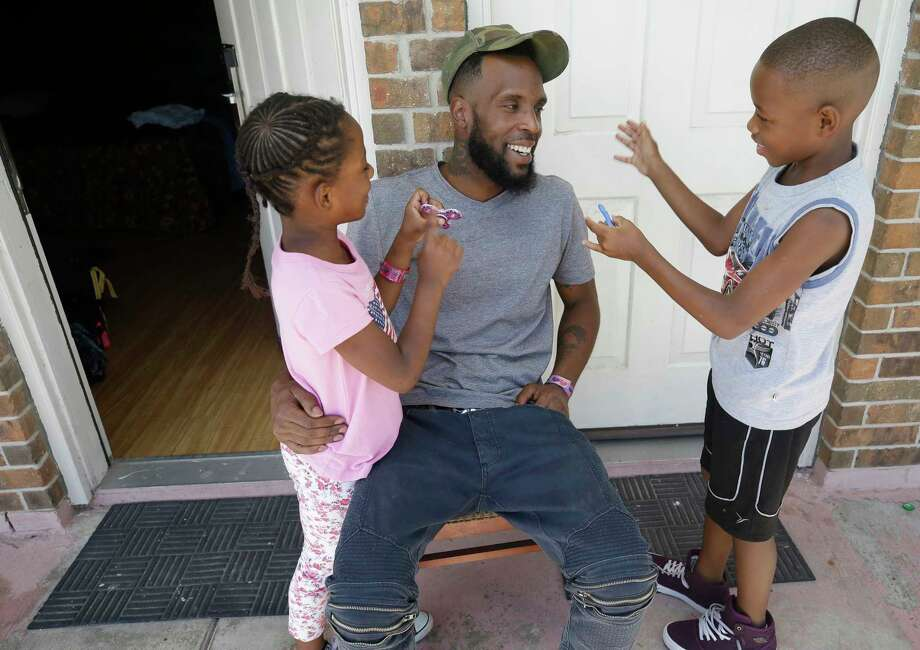 Natalie Spears, 8, and her brother Christopher Spears, 9, show  Brandon Polson their fidget spinners while in the Humble area motel Thursday, Sept. 7, 2017, where the family is staying after escaping their flooded apartment in the aftermath of Hurricane Harvey. The family has a hotel voucher from FEMA for temporary lodging through Sept. 25 and they're not sure where they'll go next. They recieved donated shoe while in a shelter. Photo: Melissa Phillip, Houston Chronicle / © 2017 Houston Chronicle