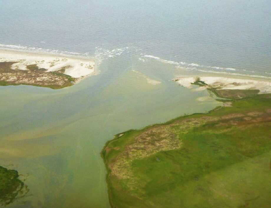 "Hurricane Harvey's storm surge and associated strong currents significantly widened and deepened what had been a narrowing, sanding Pass Cavallo near Port O'Connor. The ""new"" pass includes a channel blown through  Sunday Beach on the Matagorda Island side of the historic natural pass. Photo: Larry Likover, MD"