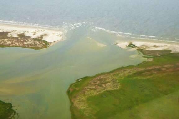 """Hurricane Harvey's storm surge and associated strong currents significantly widened and deepened what had been a narrowing, sanding Pass Cavallo near Port O'Connor. The """"new"""" pass includes a channel blown through Sunday Beach on the Matagorda Island side of the historic natural pass."""