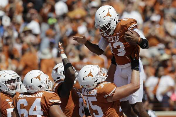 Texas quarterback Jerrod Heard (13) celebrates with teammates after he ran for a touchdown against San Jose State during the first half of an NCAA college football game, Saturday, Sept. 9, 2017, in Austin, Texas. (AP Photo/Eric Gay)