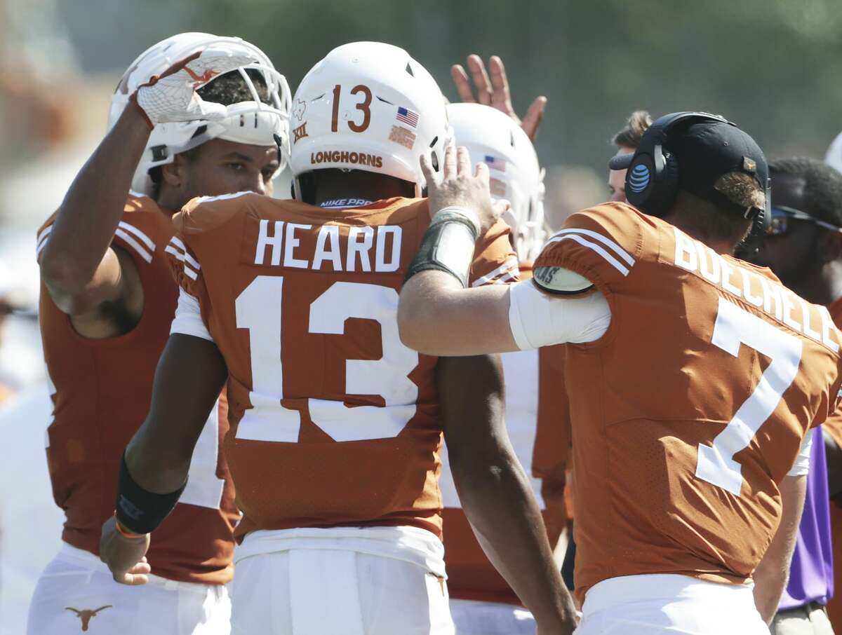 Jerrod Heard gets congratulations after his second touchdown as Texas hosts San Jose State at DKR Stadium on September 9, 2017.