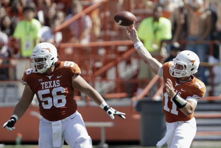 AUSTIN, TX - SEPTEMBER 09:  Sam Ehlinger #11 of the Texas Longhorns throws a pass as Zach Shackelford #56 of the Texas Longhorns protects against the San Jose State Spartans in the second quarter at Darrell K Royal-Texas Memorial Stadium on September 9, 2017 in Austin, Texas.  (Photo by Tim Warner/Getty Images) Photo: Tim Warner/Getty Images