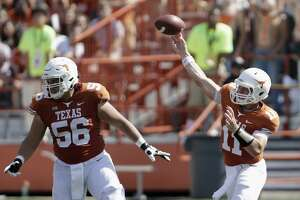 AUSTIN, TX - SEPTEMBER 09:  Sam Ehlinger #11 of the Texas Longhorns throws a pass as Zach Shackelford #56 of the Texas Longhorns protects against the San Jose State Spartans in the second quarter at Darrell K Royal-Texas Memorial Stadium on September 9, 2017 in Austin, Texas.  (Photo by Tim Warner/Getty Images)