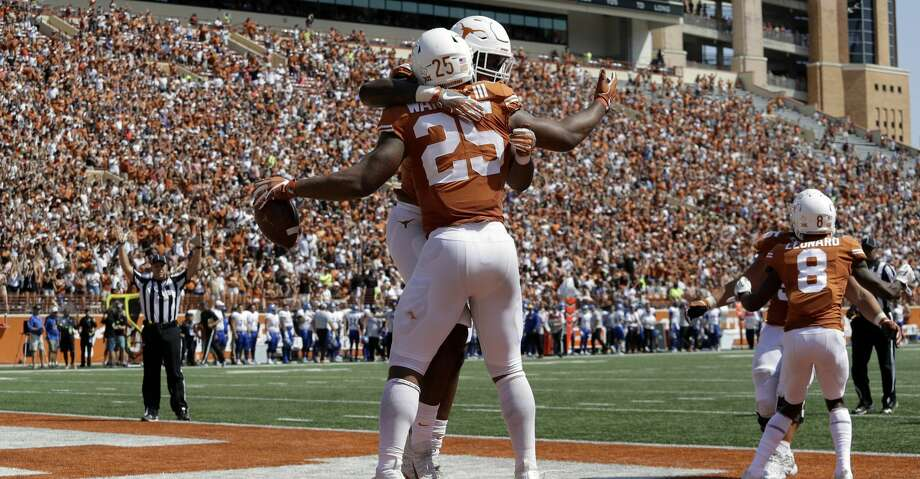 Texas running back Chris Warren III (25) celebrates his 41-yard run touchdown during the first half of an NCAA college football game, Saturday, Sept. 9, 2017, in Austin, Texas. (AP Photo/Eric Gay) Photo: Eric Gay/Associated Press