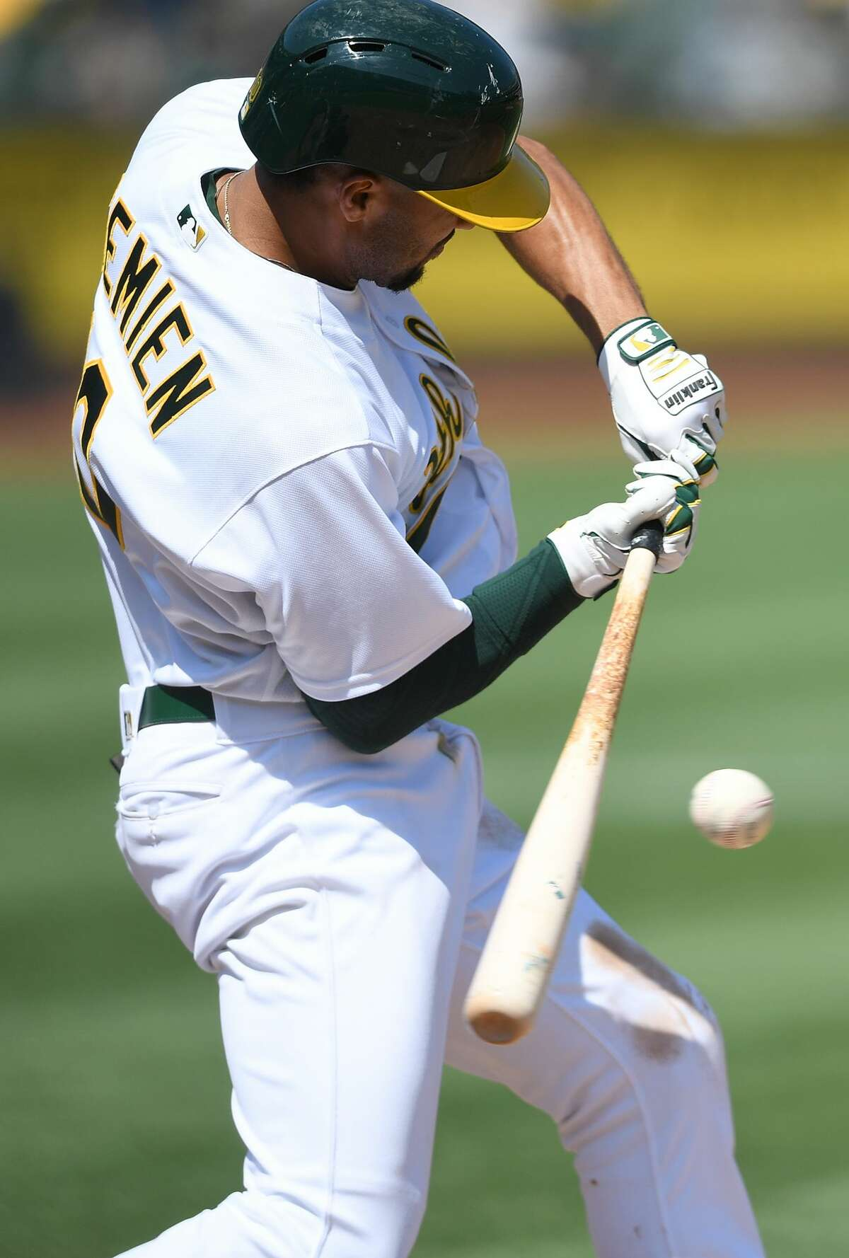 OAKLAND, CA - SEPTEMBER 09: Marcus Semien #10 of the Oakland Athletics check swing ground ball into a fielders choice which scores Boog Powell against the Houston Astros in the bottom of the second inning during game one of a doubleheader at Oakland Alameda Coliseum on September 9, 2017 in Oakland, California. (Photo by Thearon W. Henderson/Getty Images)