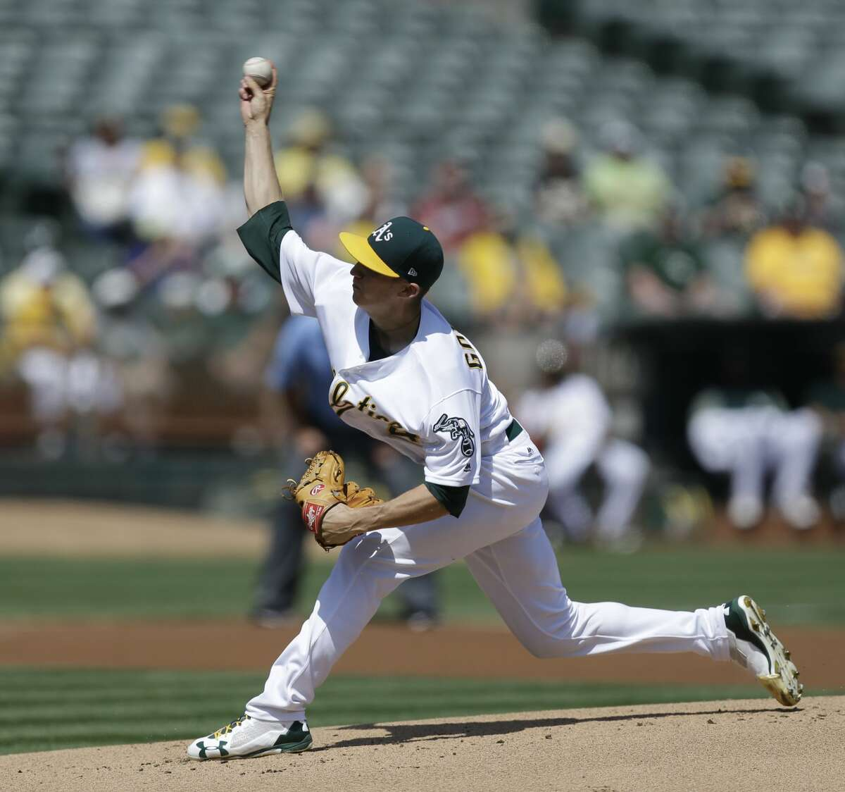 Oakland Athletics pitcher Daniel Gossett works against the Houston Astros in the first inning of the first baseball game of a double header on Saturday, Sept. 9, 2017, in Oakland, Calif. (AP Photo/Ben Margot)