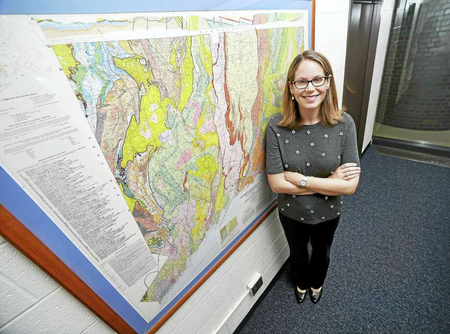 Geology and geophysics professor Maureen Long is photographed with a geological map of Connecticut at Yale University's Kline Geology Laboratory in New Haven. Photo: Arnold Gold / Hearst Connecticut Media / New Haven Register