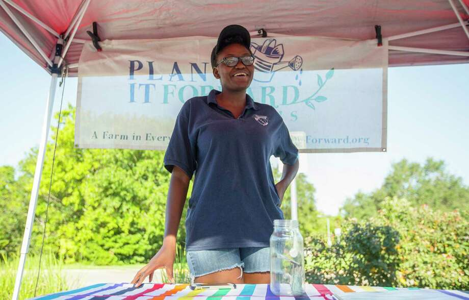 Clech Tsiba, of Plant It Forward, collects donations at their stand at the Meyerland Farmers Market, Saturday, September 9, 2017. The farm lost all of its crops during the flooding from Harvey, and they have had to buy from other farms to fill their CSA boxes. (Annie Mulligan / For The Chronicle) Photo: Annie Mulligan, For The Houston Chronicle / 2017 Annie Mulligan /  For the Houston Chronicle