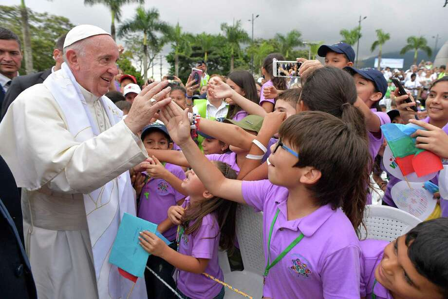 Pope Francis greets children during a prayer meeting for reconciliation at Las Malocas Park in Villavicencio, Colombia, Friday, Sept. 8, 2017. Pope Francis is visiting the area once besieged by leftist rebels to pray with victims and victimizers of Colombia's long conflict. (L'Osservatore Romano/Pool Photo via AP) Photo: POOL / Copyright 2017 The Associated Press. All rights reserved.