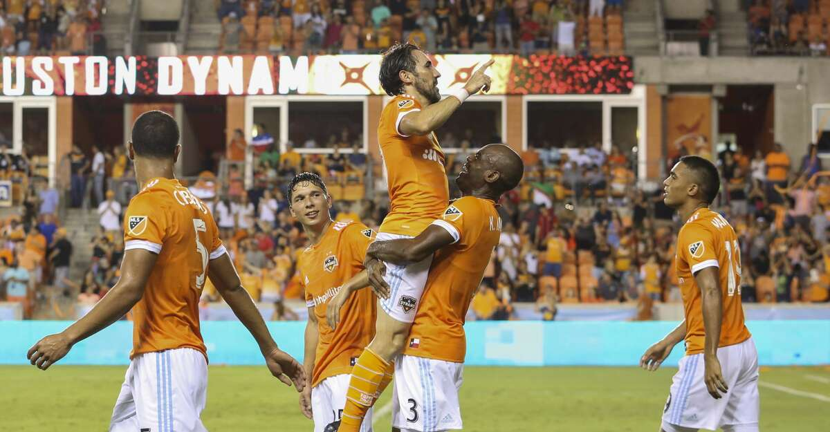 Houston Dynamo defender Adolfo Machado (3) carries forward Vicente Sanchez (10) to celebrate Sanchez's first goal of the night during the second half of the game at BBVA Compass Stadium Saturday, Aug. 12, 2017, in Houston. Houston Dynamo defeated San Jose Earthquakes 3-0.( Yi-Chin Lee / Houston Chronicle )