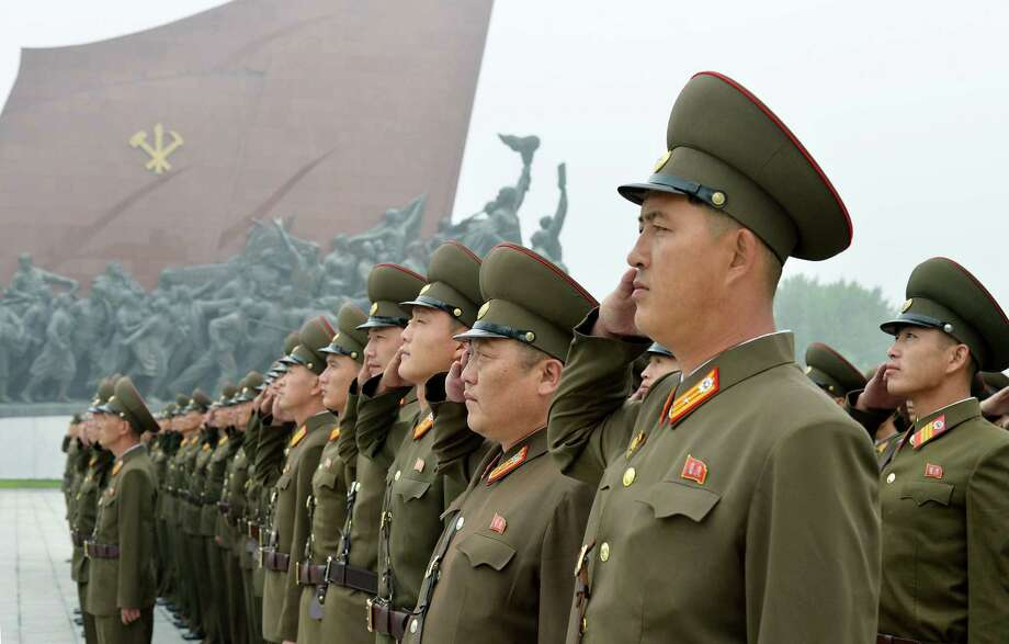 North Korean soldiers salute in Pyongyang, North Korea, to mark the 69th anniversary of the country's founding. Photo: SUB / Kyodo News
