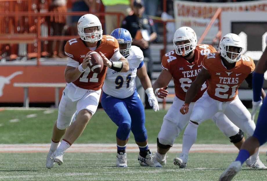 Texas quarterback Sam Ehlinger (11) looks to throw as he tuns against San Jose State during the first half of an NCAA college football game, Saturday, Sept. 9, 2017, in Austin, Texas. (AP Photo/Eric Gay) Photo: Eric Gay, STF / Copyright 2017 The Associated Press. All rights reserved.