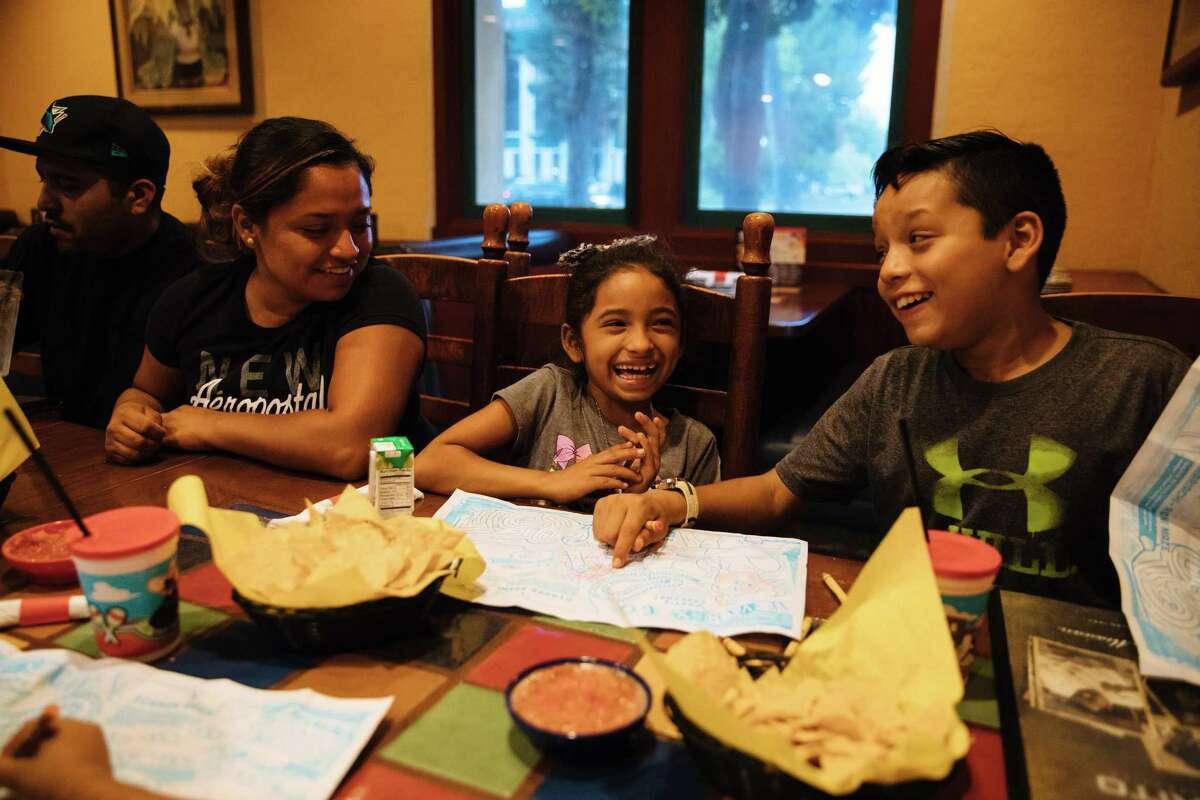 Erika Almanza (left) eats with her children, Jocelyn Cuevas, 7, and Angel Almanza, 11, at El Torito in Milpitas.