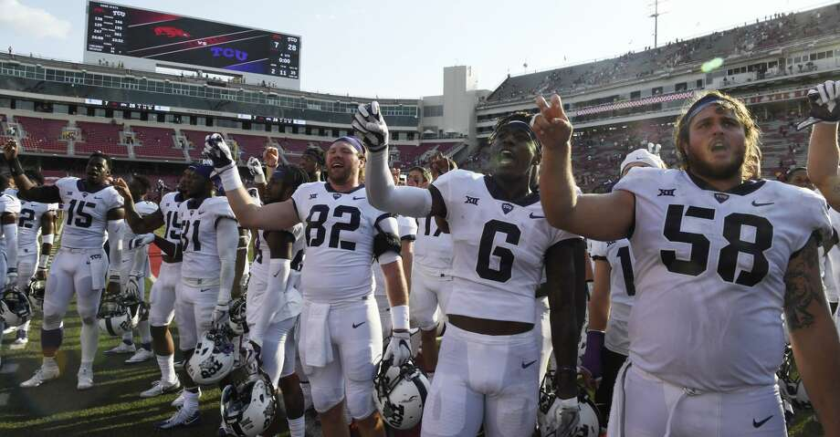 TCU players Charlie Reid (82) Darius Anderson (6) and Patrick Morris (58) celebrate their win over Arkansas after an NCAA college football game in Fayetteville, Ark., Saturday, Sept. 9, 2017. (AP Photo/Michael Woods) Photo: Michael Woods/Associated Press