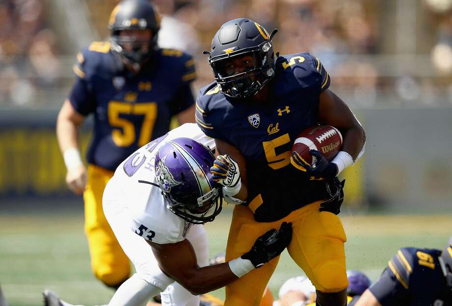 BERKELEY, CA - SEPTEMBER 09:  Tre Watson #5 of the California Golden Bears is tackled by Auston Tesch #53 of the Weber State Wildcats at California Memorial Stadium on September 9, 2017 in Berkeley, California.  (Photo by Ezra Shaw/Getty Images) Photo: Ezra Shaw, Getty Images