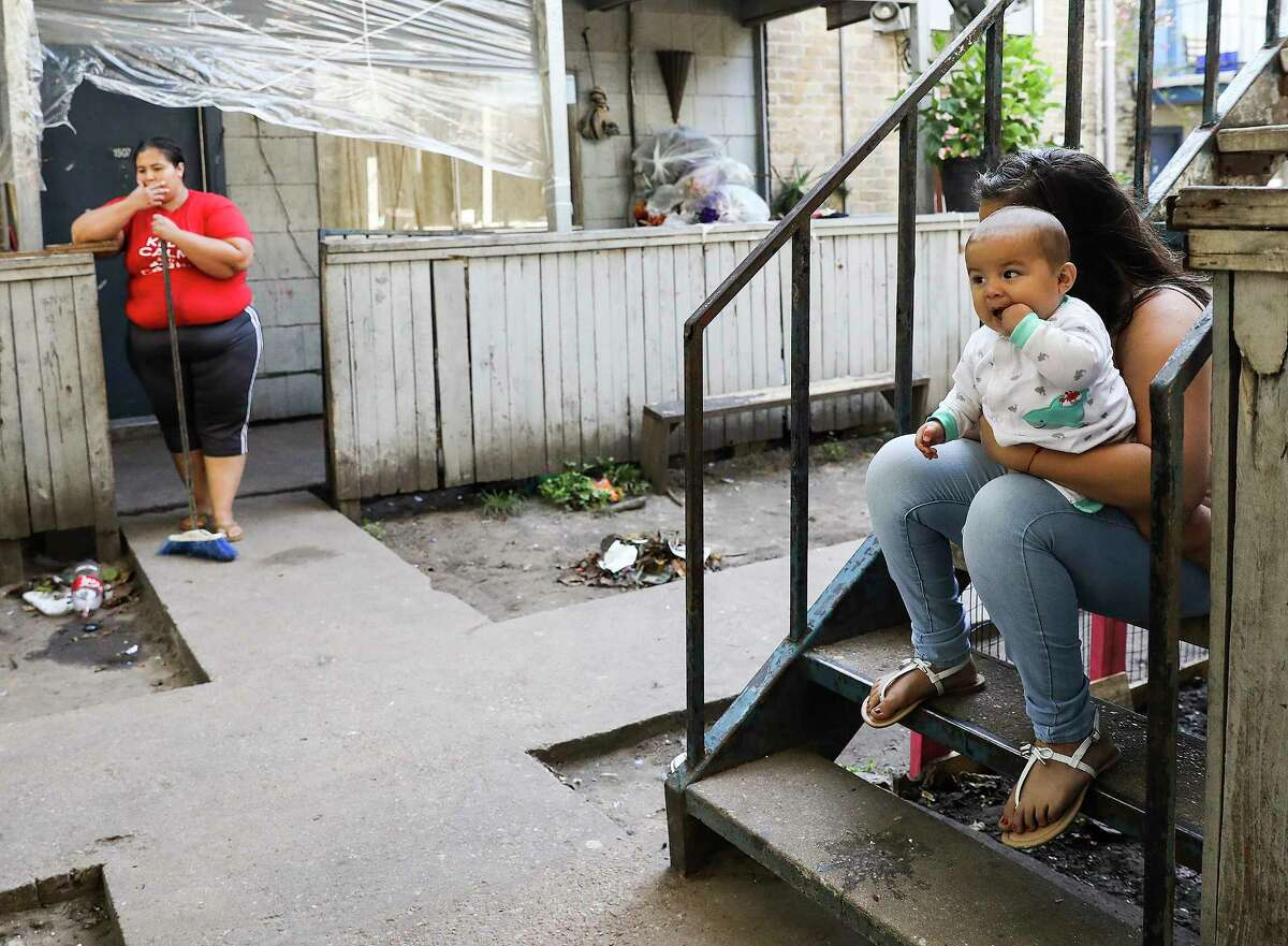 Ana Plancarte talks about the mold in her home with her daughter, Stephanie and son, Alexander Diaz outside their Rockport Apartment that was damaged by Tropical Storm Harvey on Thursday, Sept. 7, 2017, in Houston. Many had to pay September's rent, even as their apartments are unlivable. ( Elizabeth Conley / Houston Chronicle )