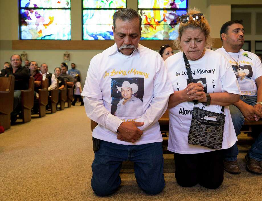 Jesus Guillen, left, and his wife Rita Ruiz de Guillen, right, kneel in prayer during mass for their son, Alonso Guillen at St. Patrick's Catholic Church on Sept. 9 in Lufkin, Texas. Alonso and two friends drove down to the Houston area to help with the rescue efforts during Tropical Storm Harvey. The three volunteers went missing after their boat hit the Interstate 45 southbound frontage road bridge and capsized. Photo: Godofredo A. Vasquez, Houston Chronicle / Godofredo A. Vasquez