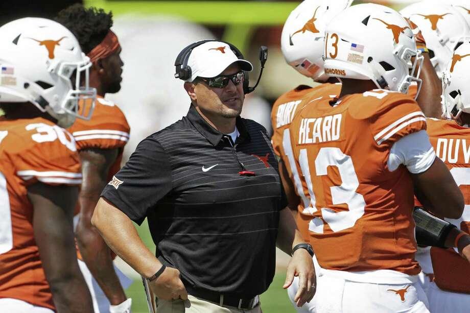 Coach Tom Herman circulates among his players as Texas hosts San Jose State at DKR Stadium on September 9, 2017. Photo: Tom Reel, Staff / San Antonio Express-News / 2017 SAN ANTONIO EXPRESS-NEWS