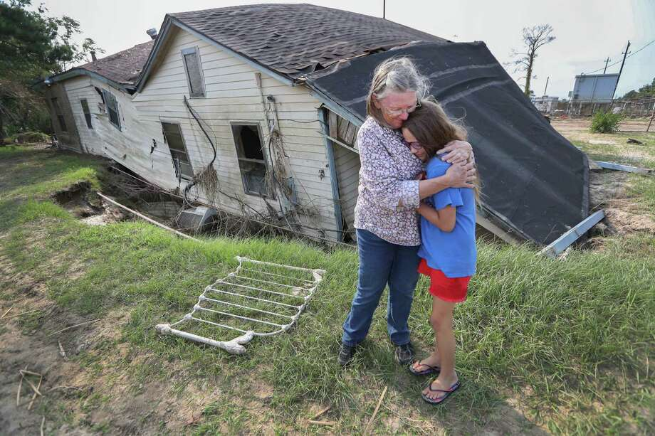 Linda Bonner, 71, embraces her granddaughter Gaige-Lyn Gray in front of ther home in Channelview, about a mile away from the San Jacinto Waste pits and destroyed by Hurricane Harvey. She does not plan to rebuild her home of nearly 40 years.  Photo: Steve Gonzales, Staff / © 2017 Houston Chronicle