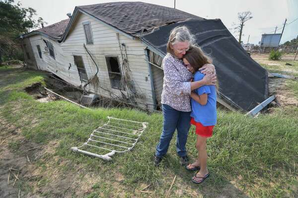 Linda Bonner, 71, embraces her granddaughter Gaige-Lyn Gray in front of ther home in Channelview, about a mile away from the San Jacinto Waste pits and destroyed by Hurricane Harvey. She does not plan to rebuild her home of nearly 40 years.