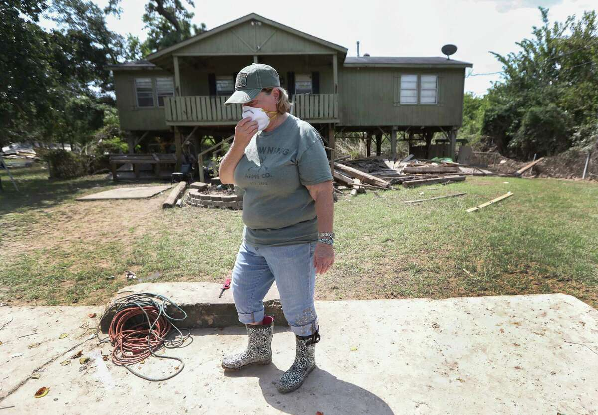 Jennifer Harpster, who lives next to the San Jac waste pits, covers her nose and mouth from the toxic smell in and around her home in Channelview.