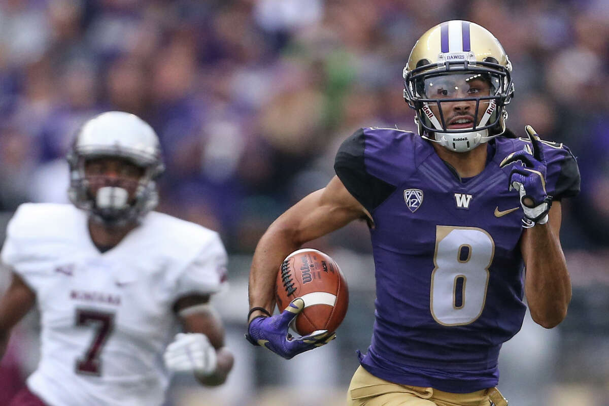 University of Washington wide receiver Dante Pettis returns the ball to the end zone from a kickoff during University of Washington's first home game against Montana on Saturday, Sept. 9, 2017.
