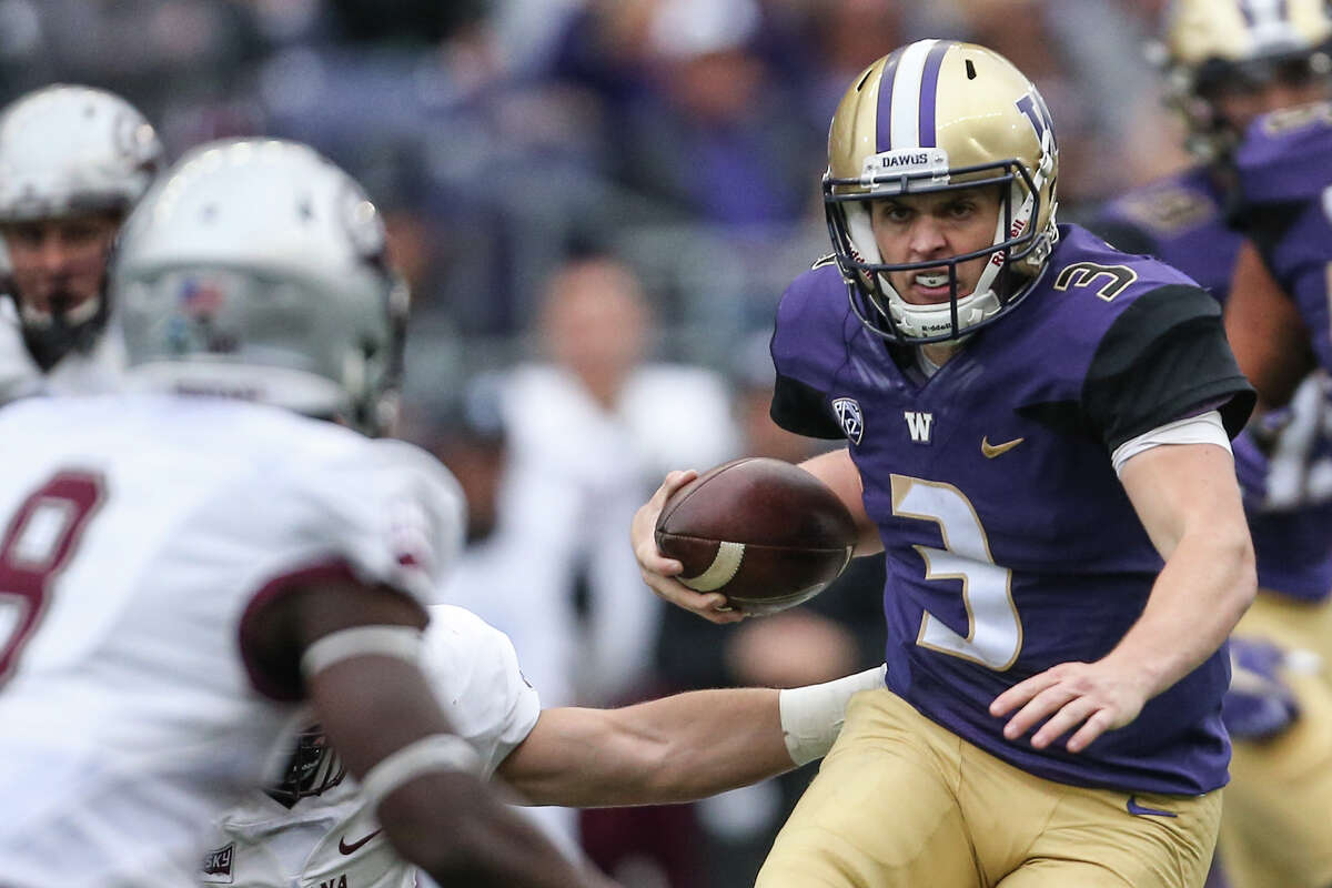 University of Washington quarterback Jake Browning runs the ball during the first half of their first home game, against Montana on Saturday, Sept. 9, 2017.
