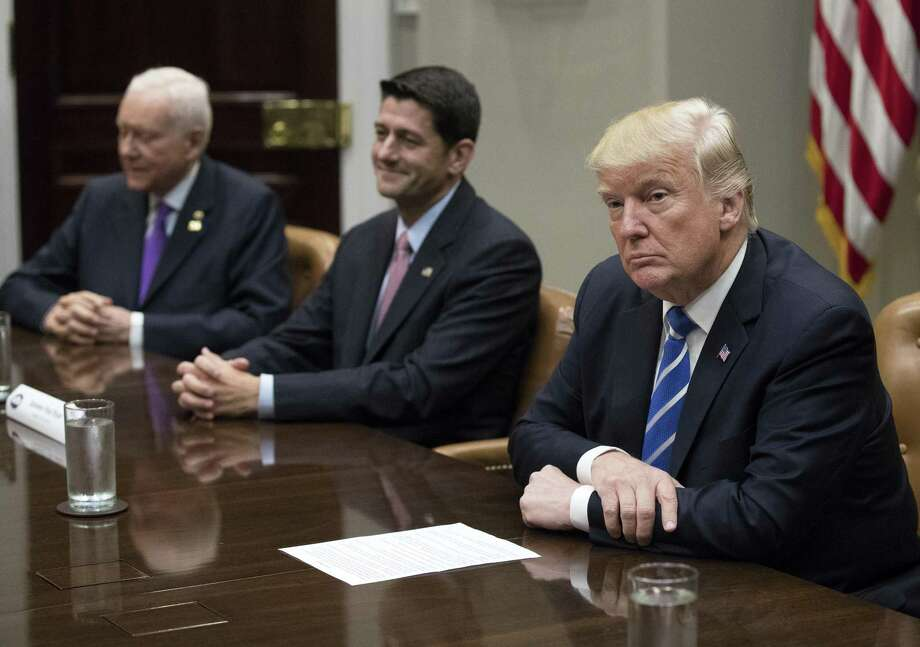 U.S. President Donald Trump, right, sits with U.S. House Speaker Paul Ryan, a Republican from Wisconsin, center, during a meeting with members of Congress and Trump's administration regarding tax reform in the Roosevelt Room of the White House in Washington, D.C., U.S., on Tuesday, Sept. 5, 2017. Congress, back from its August vacation, has less than a month to avert a default on the nations debt and avoid a government shutdown. The pressure of dealing with Harveys destruction, possible more damage from Hurricane Irma and the North Korea crisis could make a fiscal fight less likely. Photographer: Shawn Thew/Pool via Bloomberg Photo: Shawn Thew / Bloomberg / © 2017 Bloomberg Finance LP