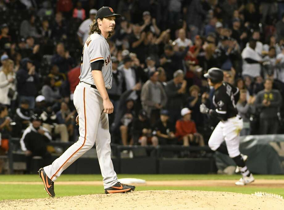 Giants starter Jeff Samardzija (left) reacts as Avisail Garcia of the White Sox rounds the bases after homering in the fifth inning on Saturday. Samardzija allowed six runs in taking the loss. Photo: David Banks, Getty Images