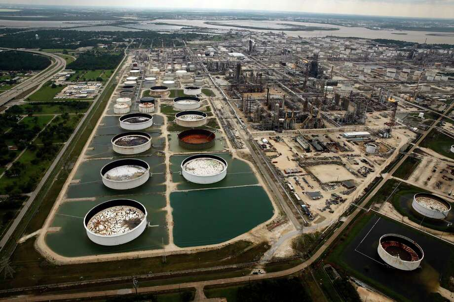 FILE - In this Wednesday, Aug. 30, 2017 file photo, large storage tanks situated in retention ponds are surrounded by rainwater left behind by Tropical Storm Harvey at ExxonMobil's refinery in Baytown, Texas. Photo: Tom Fox, MBR / The Dallas Morning News