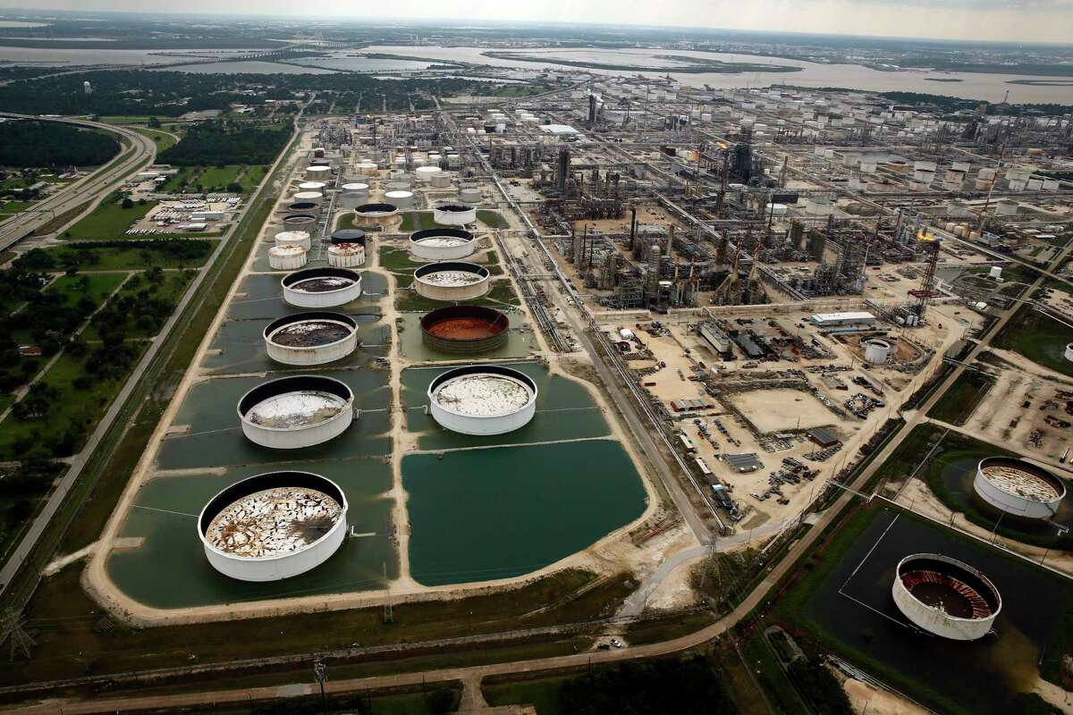 Storage tanks in retention ponds are surrounded by rainwater left behind by Tropical Storm Harvey.